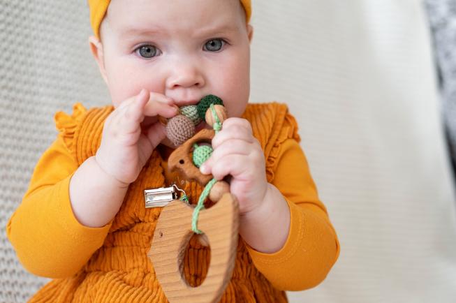 trẻ 9 tháng chưa mọc răng
